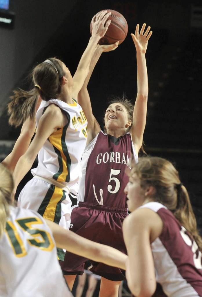 Alexa Coulombe of McAuley blocks a shot by Mia Rapolla, who finished with 21 of the 30 points by Gorham in McAuley's 39-30 victory.