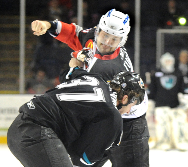 Colin Stuart of the Portland Pirates, top, mixes it up with Sean Sullivan of the Worcester Sharks on Tuesday at the Cumberland County Civic Center.
