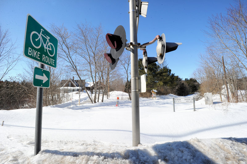 Old railroad lights sit idle where the Sebago to the Sea Trail ends for now in South Windham. About six miles of paved trail have been completed next to the track from Standish to South Windham.