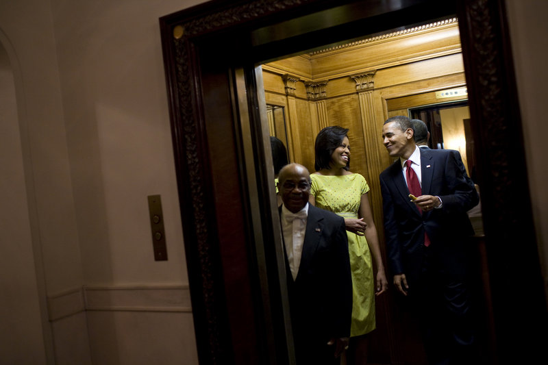 President Obama holds a tortilla from the buffet table at the White House Cinco de Mayo celebration as he and first lady Michelle Obama take an elevator to the private residence after the event on May 4, 2009.
