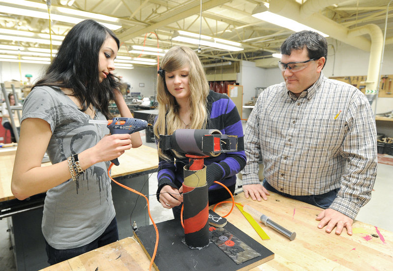 Gorham freshmen Katherine O'Connor and Julie Pearson work on a project as technology instructor Randy Perkins looks on. The school is ranked as one of the top 90 in Maine.