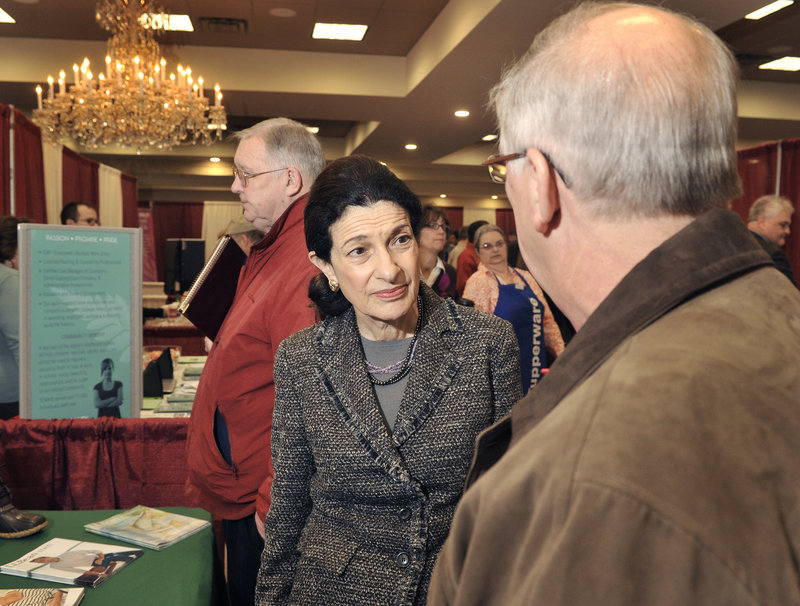 """Maine Sen. Olympia Snowe chats Tuesday with a job fair visitor. She said the number of job seekers there """"underscores the dimension of unemployment problems"""" in the state."""