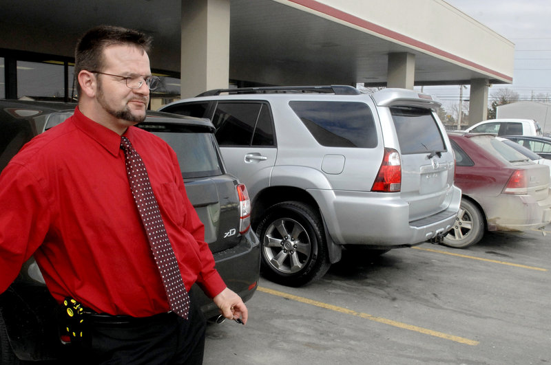 Moses Gingerich surveys the Joe Machens dealership in Columbia, Mo., after preparing a vehicle for a customer. Gingerich, who left an Amish community in Wisconsin, works as a car salesman and mentors other ex-Amish who are trying to adjust to the modern world.
