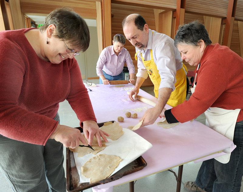 Donna Landau, Lisa Munderback, Steve Steinbock and Toby Rosenberg formed a matzah-making assembly line last week at Congregation Bet Ha'am in South Portland.