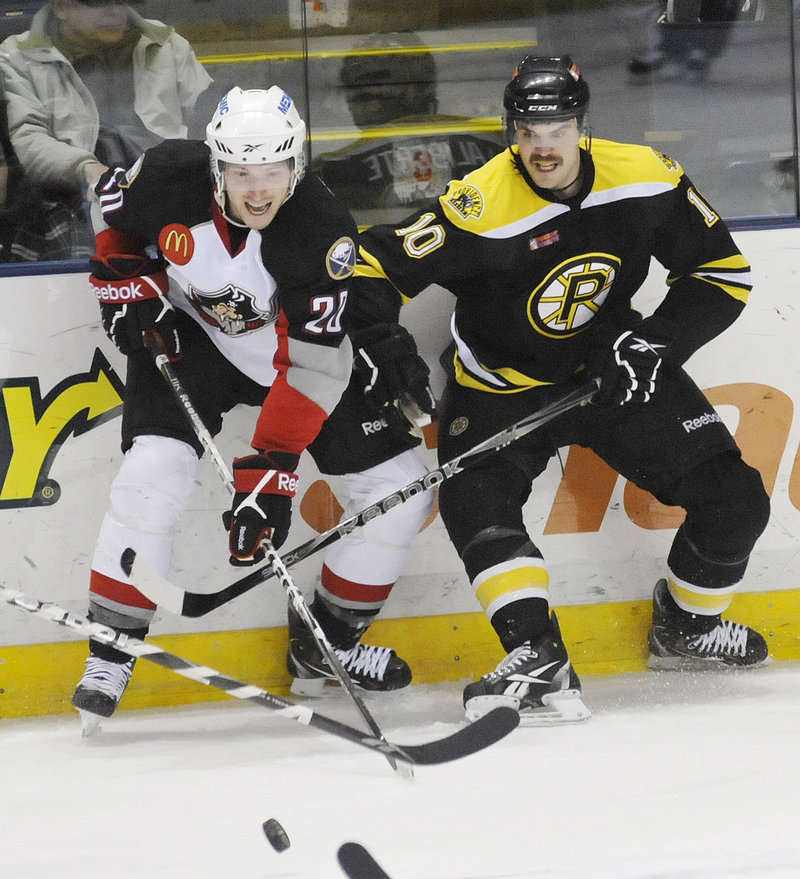 Portland's Nick Crawford, left, tries to outmaneuver Providence's David Laliberte for the puck. The Pirates ended a three-game losing streak.
