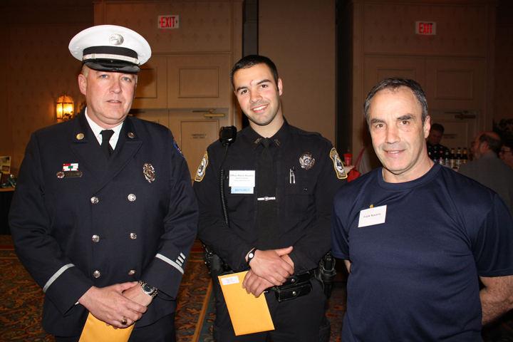 Heroes with Heart award winners Lt. Aaron Osgood of the Portland Fire Department and Office Rocco Navarro of the South Portland Police Department, with Frank Navarro, Rocco's dad and a member of the Portland Fire Department.