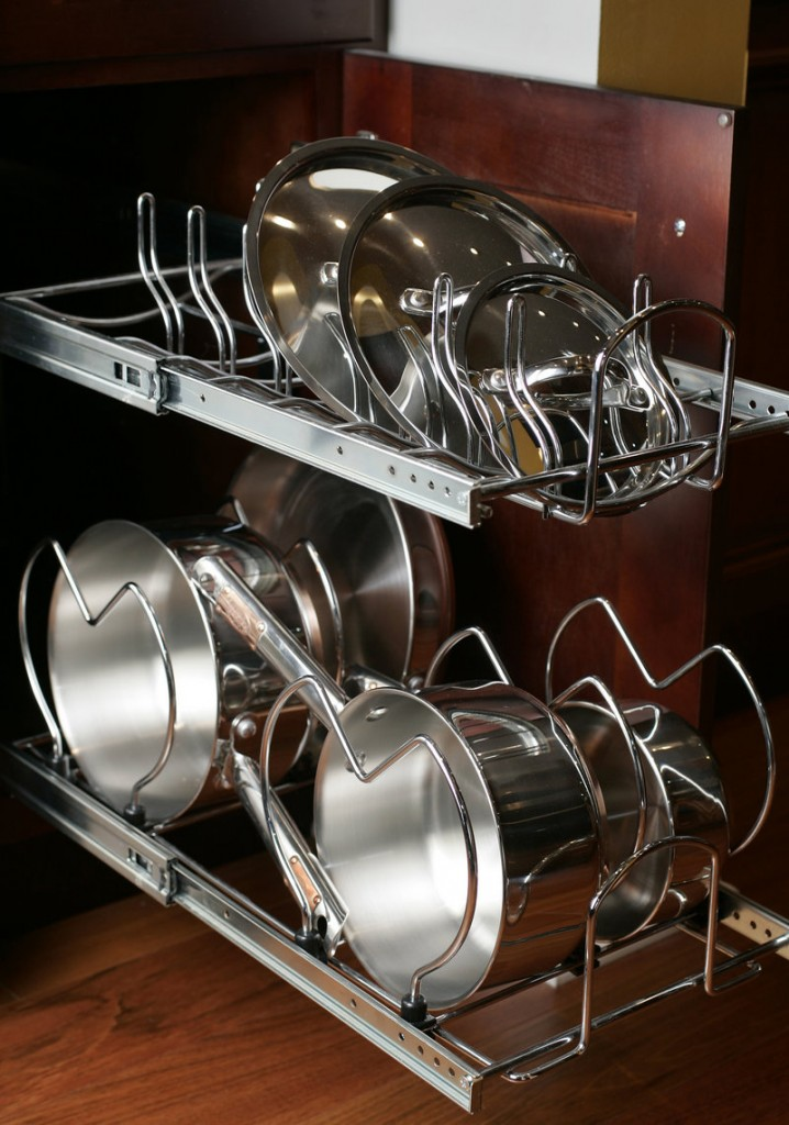 A pull-out pot rack installed in a kitchen cabinet can save precious space.