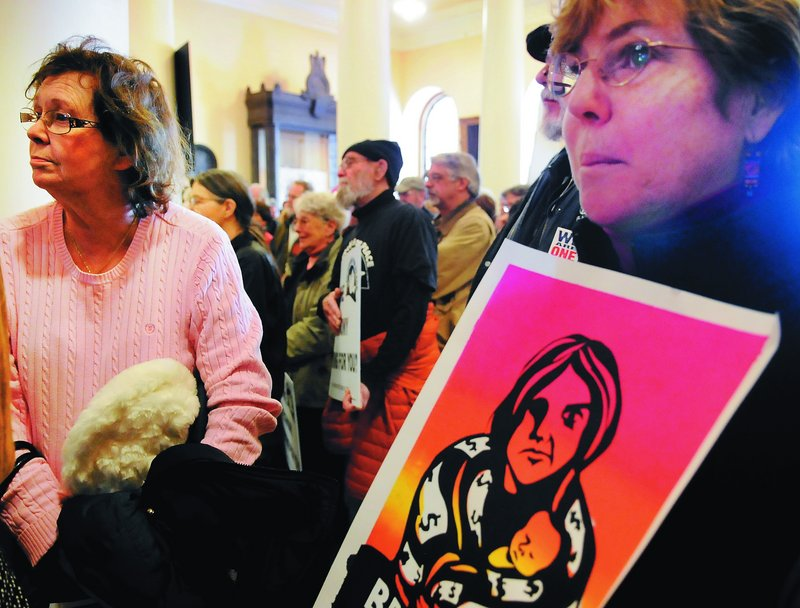 """Demonstrators rally Monday at the State House. Portland City Councilor David Marshall said LePage """"has taught us more about Maine's labor history than we have ever known."""""""