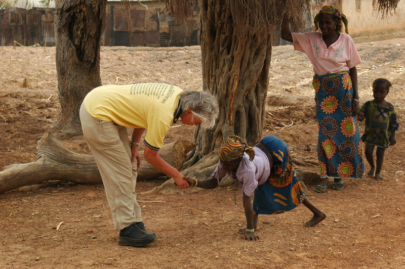 Ann Lee Hussey of South Berwick greets polio victim Uma in the village of Fulani Doka Maijama, Nigeria, in 2008. Surviving polio has given Hussey a link to people she helps overseas through Rotary International.