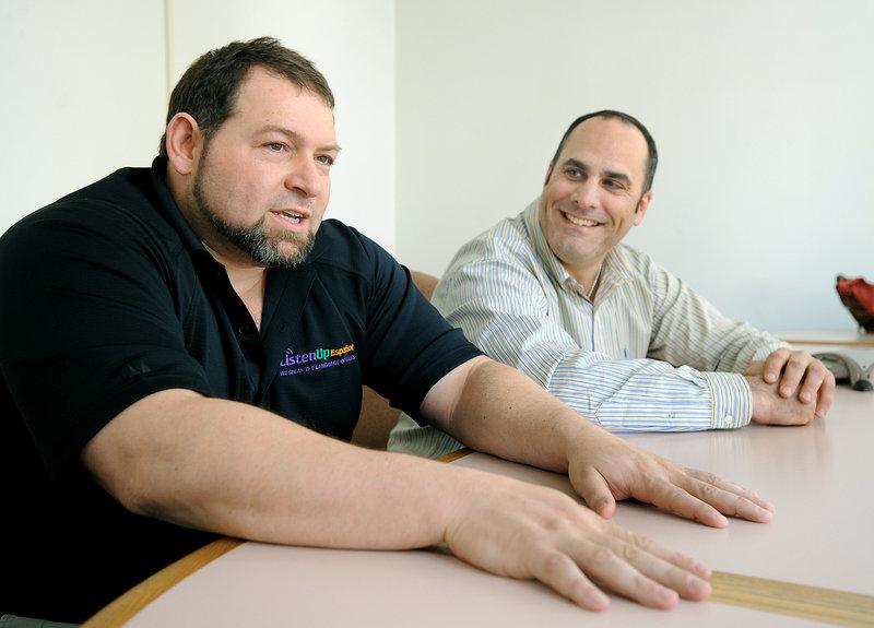 CEO Craig Handley, left, and President Tony Ricciardi of Listen Up Español work from an office in Portland.