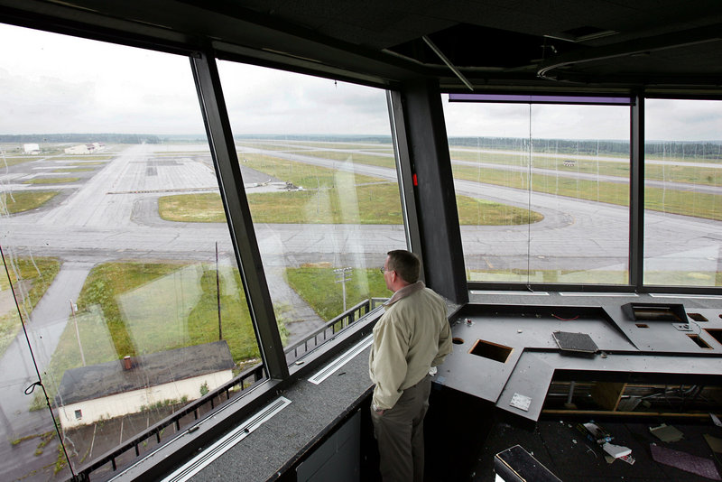 The Loring facilities manager looks out at the empty tarmac at the former Air Force base in 2005.