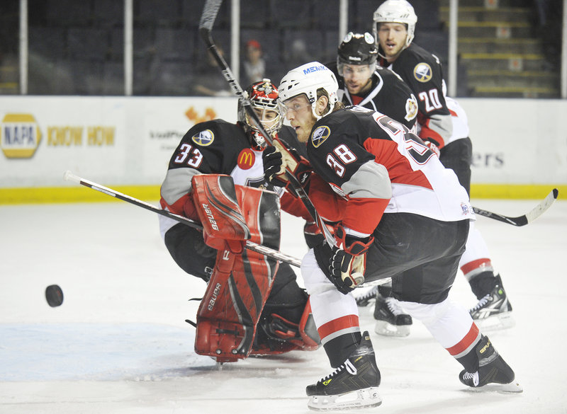 Tim Conboy and goalie David Leggio of the Pirates watch as the puck bounces away Wednesday night during Binghamton's victory in the opener of their AHL playoff series at the Cumberland County Civic Center.