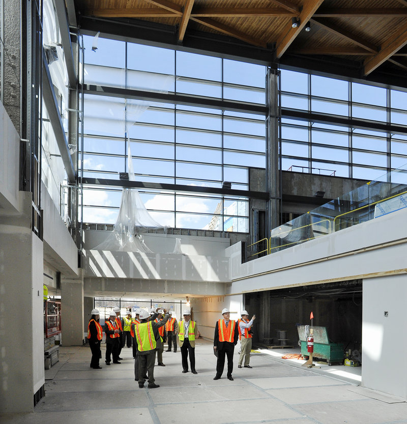 A group of officials gets a look at upgrades under way at the Portland Jetport on Friday. The improved terminal will open in October.