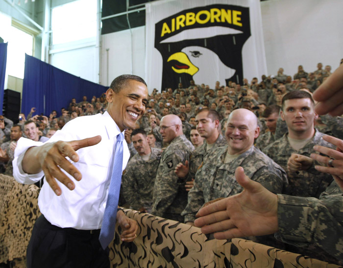 President Barack Obama greets military personnel at Fort Campbell, Ky., today.