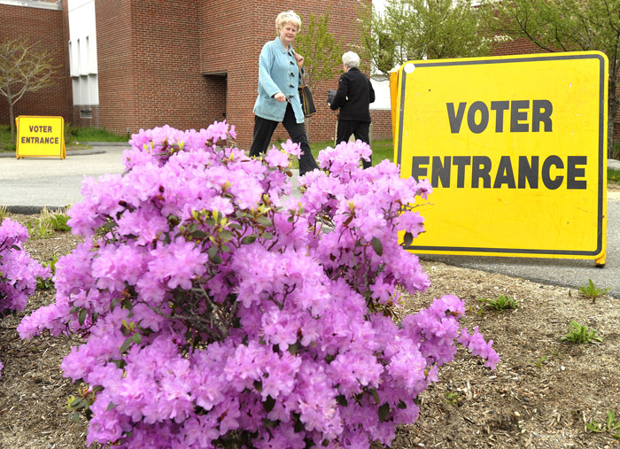 Cape Elizabeth voters come and go at the high school as they turned out to cast their votes in today's election.