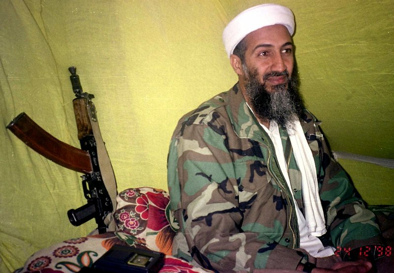 Al-Qaida leader Osama bin Laden speaks to a group of reporters in southern Afghanistan in 1998. Bin Laden surrounded himself with a private army and declared a holy war against the United States.