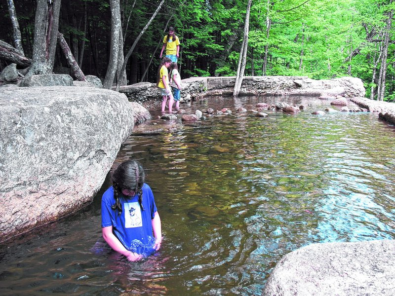 In the summer, Diana's Baths in Bartlett, N.H., is a favorite place for the Almeida kids to cool off and splash around.