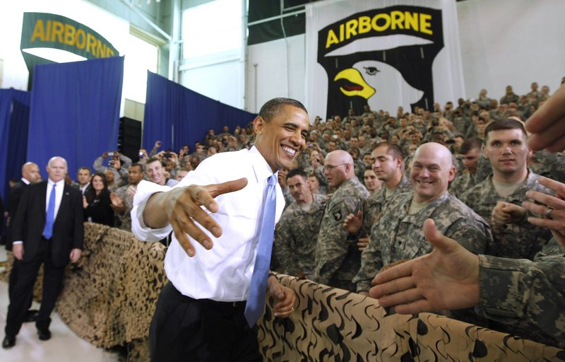 """President Obama greets military personnel prior to addressing troops Friday at Fort Campbell, Ky. Obama also met privately with the commandos he sent after terror mastermind Osama bin Laden. Obama called the bin Laden raid one of the most successful intelligence and military operations in America's history, and said he had to come to extend personal thanks. Obama said his meeting with special operations forces """"was a chance for me to say on behalf of all Americans and people around the globe, job well done, job well done."""" The identities of the men who killed bin Laden are likely to remain secret forever. White House officials released few details of Friday's meetings and would not formally confirm whether Obama actually met members of Navy SEAL Team 6, whose existence is officially classified."""