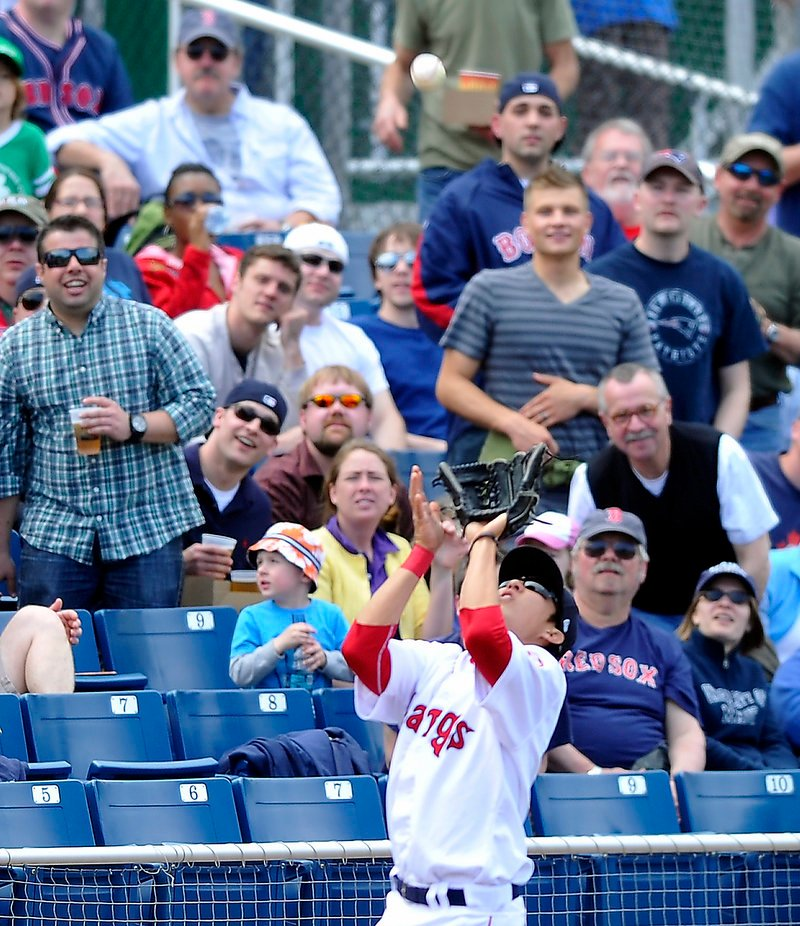 Jonathan Hee of the Portland Sea Dogs delights the crowd Saturday while catching a foul pop in front of the third-base railing. It was a delightful day for the Dogs at Hadlock Field – four home runs in a 15-7 win over New Britain.
