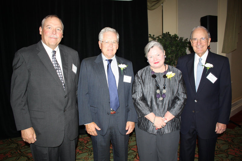 Bill and Bruce Chalmers, who own Chalmers Insurance Group, Brenda Garrand, who owns Garrand, and outgoing U.S. Special Envoy for Middle East Peace and Maine Sen. George Mitchell were all given the Laureate Award and inducted into the Maine Business Hall of Fame.