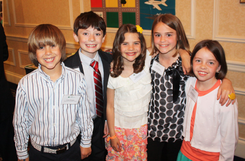 Third-grade students Kyle Bass, Evan Morgan, Sydney Kokos, Sarah Callahan and Samantha Brodeur of Wentworth Intermediate School in Scarborough presented their Junior Achievement work during the party.