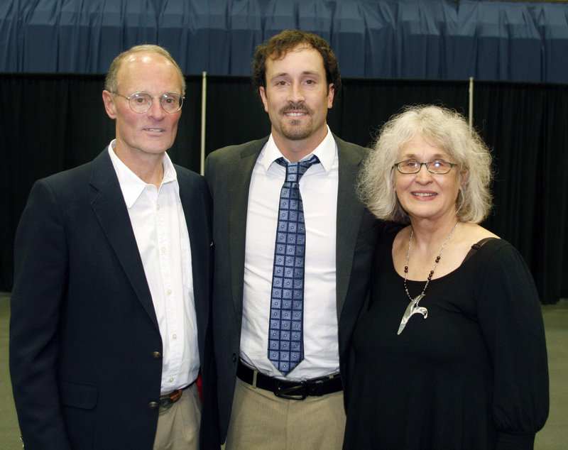 Olympic snowboardcross gold medalist Seth Wescott is flanked by his mother, Margaret, and his father, Jim, a former cross country and track and field coach at Colby College.