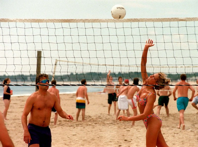 Beachgoers play volleyball at Old Orchard.