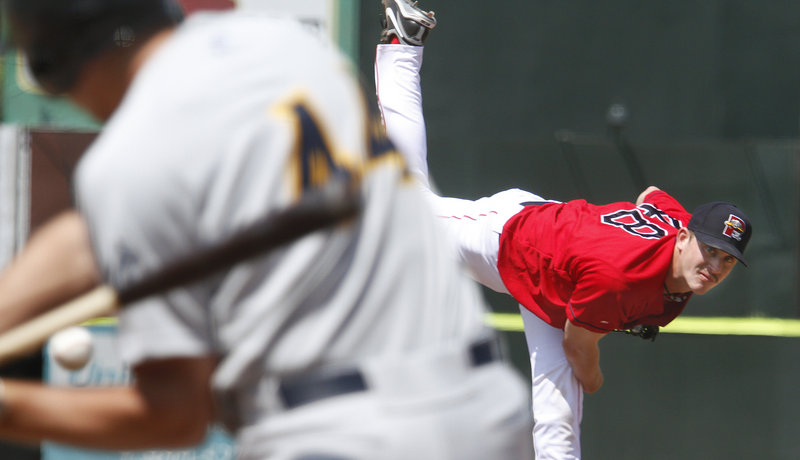Portland starter Michael Lee throws to Trenton's Cody Johnson during fifth-inning action of a 5-2 Sea Dogs loss Sunday at Hadlock Field. Lee (1-4) continues to put up good numbers in most areas except wins, as he threw 6 2/3 shutout innings against the Thunder, allowing two hits.