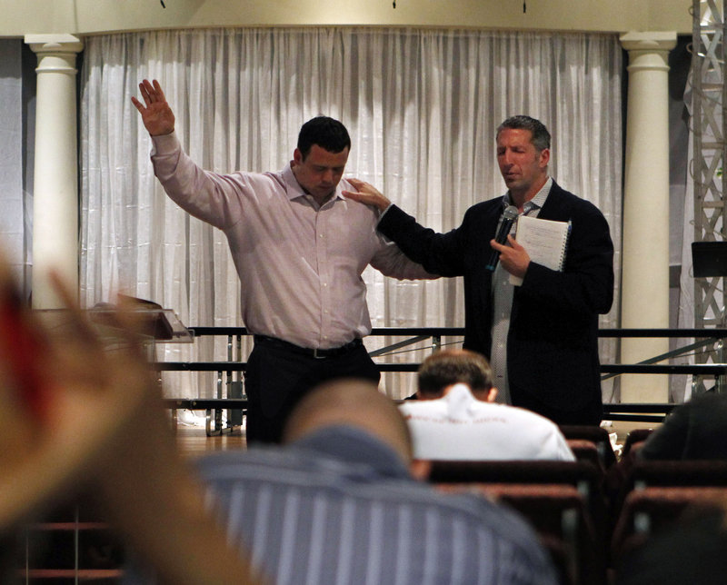With the assistance of Adam Burt, right, a former National Hockey League defenseman, Mike DeVito was able to speak for about 20 minutes last week to a congregation, talking about his faith and how it developed while he was playing football at the University of Maine.