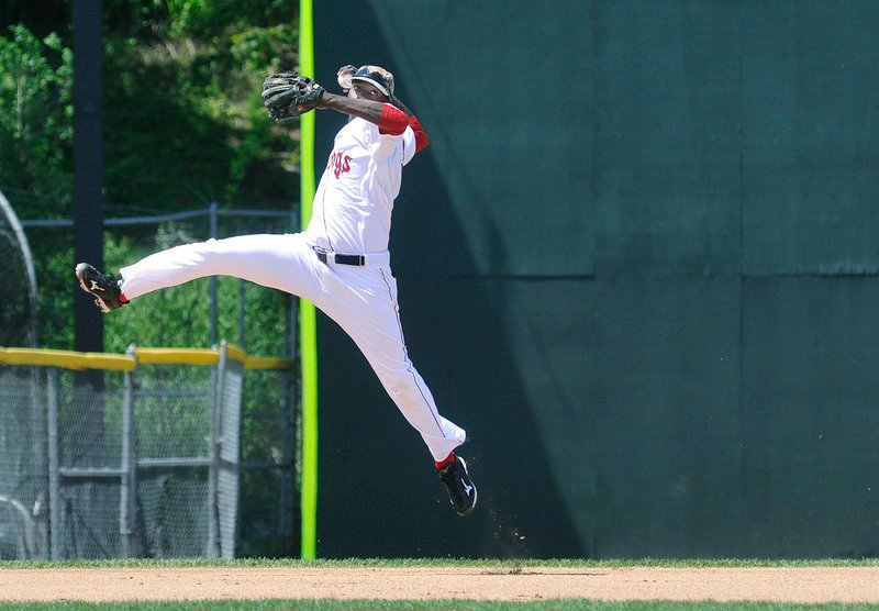 Vladimir Frias, the shortstop for the Portland Sea Dogs, gets an opportunity to show off his arm Monday while making a leaping throw to first base during the Memorial Day game against the Trenton Thunder at Hadlock Field. Trenton rallied for a 6-4 victory.