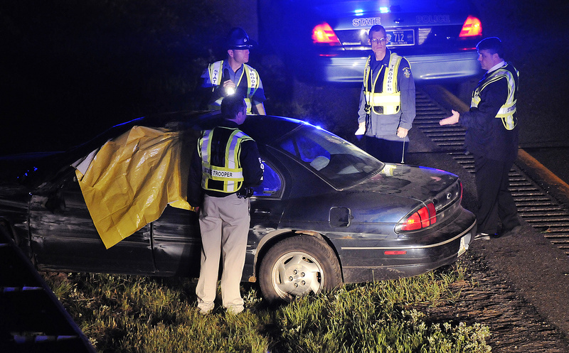 Maine State Police troopers gather around Nathaniel Gordon's vehicle after it crashed and he killed himself just off Exit 63 on Interstate 95 late Monday night.