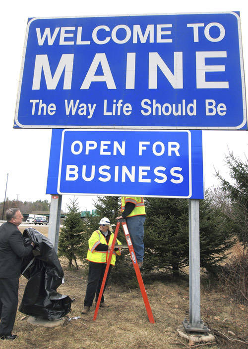 In this March 18, 2011, photo, Gov. Paul LePage, left, unveils the