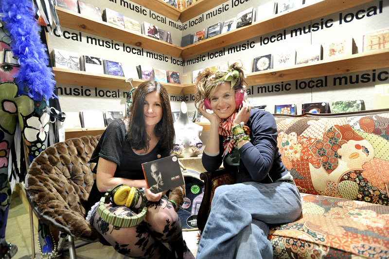 Robin Ivy, left, morning show host on WCYY Radio, has helped Meredith Alex promote southern Maine musicians at Alex's Commercial Street shop.