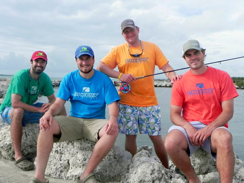 Cheeky Fly Fishing partners Peter Crommett, Ted Upton, Scott Caras and Max Key take a break from testing a prototype of their new fly reel in the Florida Keys.