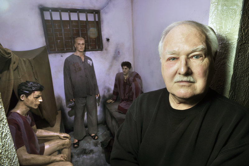 Lee Humiston will welcome state officials and hundreds of guests, including former prisoners of war, at the grand opening of the Maine Military Museum and Learning Center in South Portland on Saturday. Here he stands outside a replica of a North Vietnamese prisoner of war cell he created from artifacts he had collected.