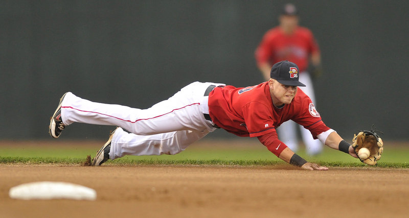 Sea Dogs shortstop Ryan Khoury makes a diving stop and robs New Britain's Mark Dolenc of a base hit in the first game of a doubleheader Tuesday night. The Sea Dogs earned a split with a 12-5 win in the second game.
