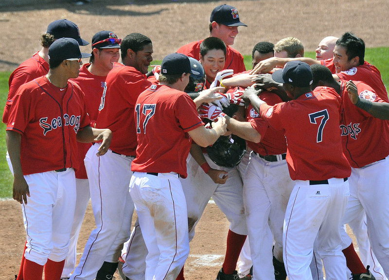 Alex Hassan did something Wednesday he'd never done before: He hit a walk-off home run. And his teammates responded with back-pounding as the Portland Sea Dogs emerged with a 4-3 victory against the New Britain Rock Cats at Hadlock Field.
