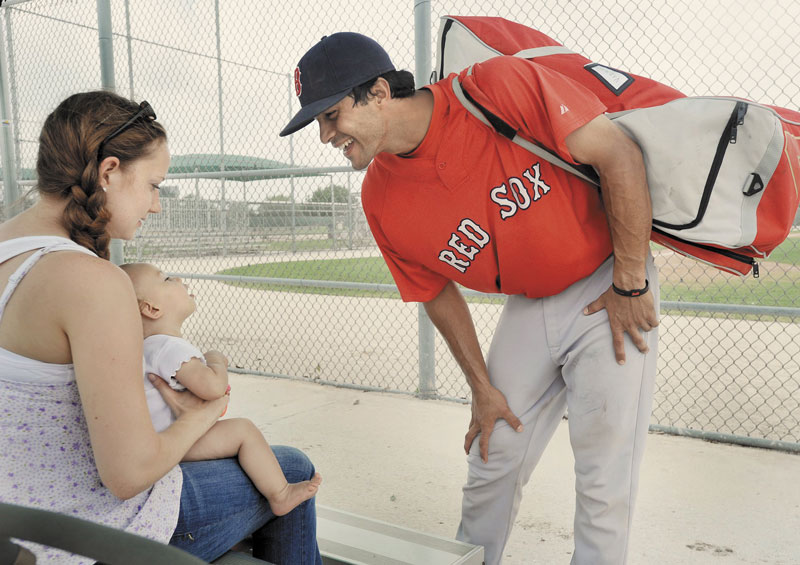 Portland Sea Dogs backup catcher/infielder Will Vazquez talks with his wife Hannah and their daughter Mia during spring training. The 26-year-old Vazquez played his final game with the Sea Dogs Friday night.