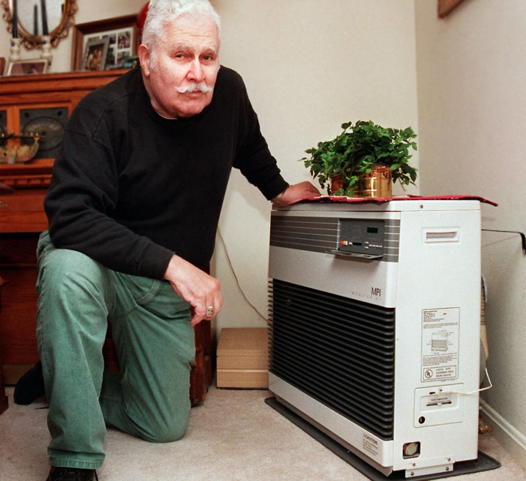 Jim Friedlander shows the Monitor heater that he uses to heat his home in Brunswick. Fuel economy and low installation costs made direct-vent heaters like the Monitor popular in cold-weather climates with high energy prices, including the Northeast, Pacific Northwest and Alaska.