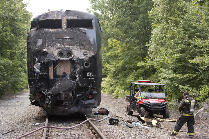 The Downeaster engine's charred remains sit near the collision scene in North Berwick.