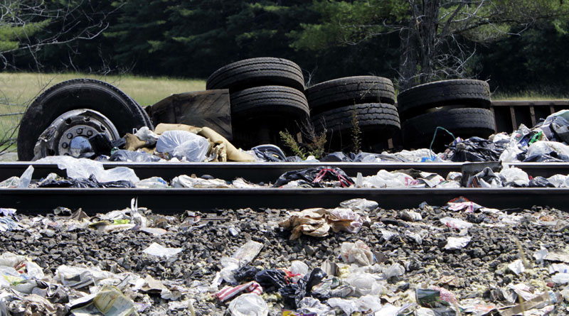 Wreckage of the trash-hauling tractor-trailer lies alongside the tracks at the site of the collision.
