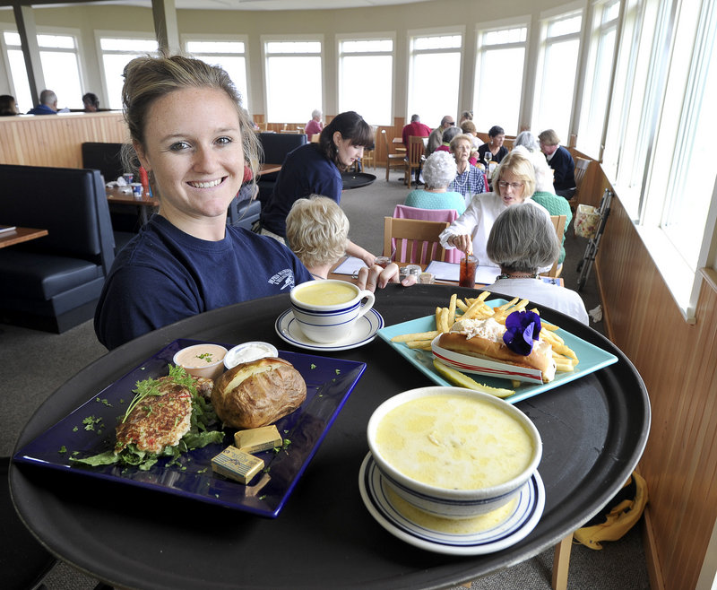 Server Krysten Libby makes a delivery of crab cakes, fish chowder and a lobster roll at the new Dolphin Marina and Restaurant in South Harpswell.