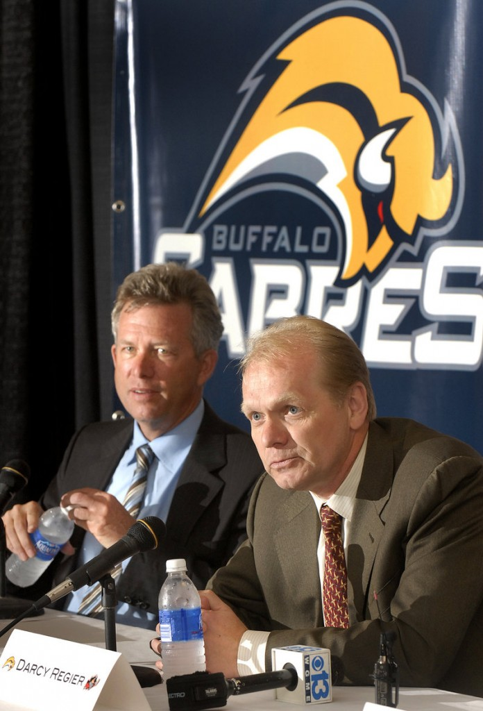 Buffalo Sabres, 2008-2011: Buffalo Managing Partner Larry Quinn, left, and General Manager Darcy Regier announce an affiliation with the Pirates in 2008.