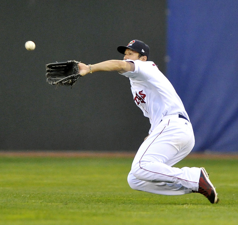 Sea Dogs right fielder Chih-Hsien Chiang makes a sliding catch on a fly ball in a 10-6 win over New Hampshire.