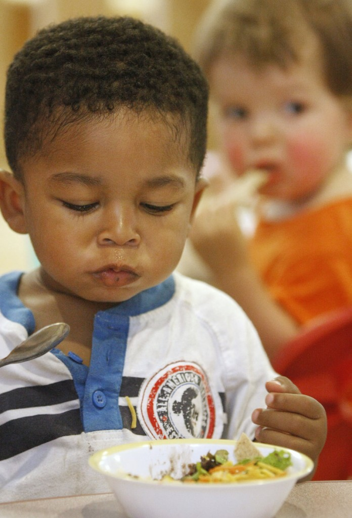 Makai Man enjoys lunch with fellow toddlers.