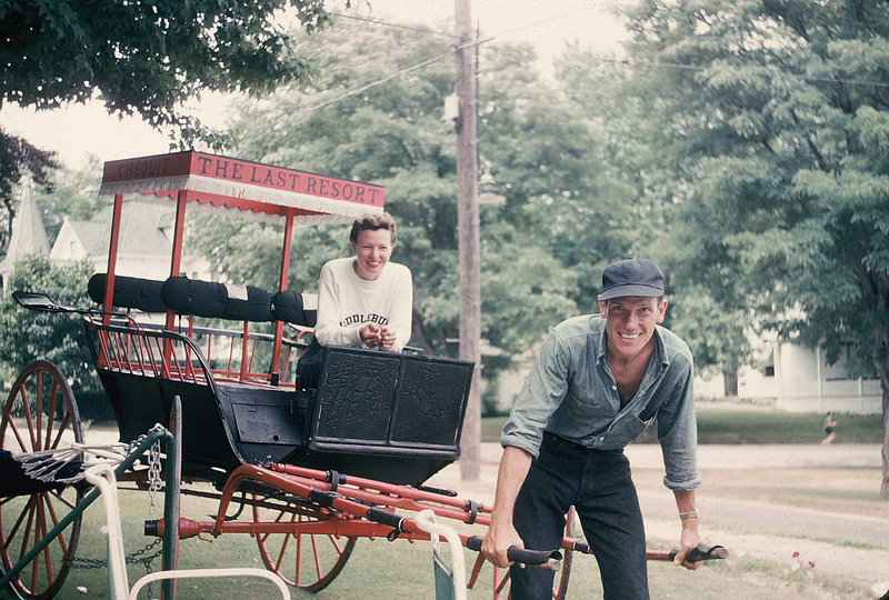 Norman Morse horses around with a cart carrying a friend while visiting Shelter Island, on Long Island, N.Y., in 1950.