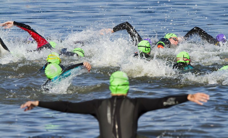And off they go, leaving Peaks Island for the blue waters of Casco Bay, with East End Beach in Portland as the destination Saturday in the 30th annual Peaks to Portland Swim.