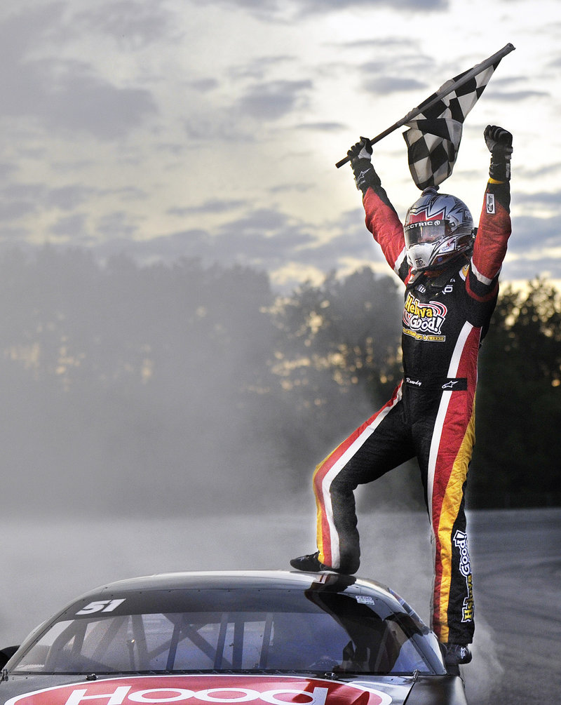 Kyle Busch shares the moment with fans in the stands of Maine's biggest auto race of the year on Sunday at Oxford Plains Speedway. Busch placed 22nd in 2006 and sixth in 2005.