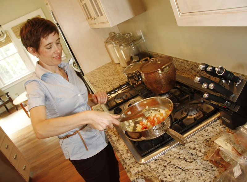 Chris McClay of Modern Vegan prepares vegetables for a shepherd's pie in a client's kitchen in Falmouth. McClay cooks up to five days' worth of plant-based meals in one visit.