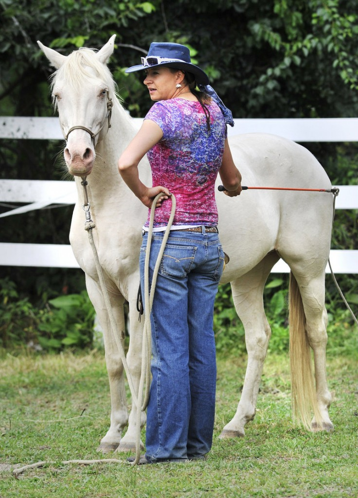 Farrah Green, a South Dakota trainer, works with one of the horses that will participate in a weekend performance piece with human dancers at a farm in Pownal. Green also encourages the human participants in the program to think like horses.